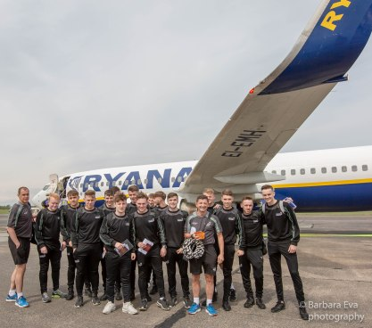 The squad pose for a photo at the start of the trip.